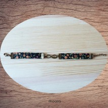 Bracelet noir fleuri bronze infinity