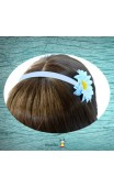 Serre-tête bleu et fleur gerbera